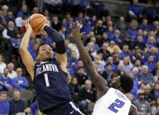 Villanova's Jalen Brunson (1) shoots over Creighton's Khyri Thomas (2) during the first half of an NCAA college basketball game in Omaha, Neb., Saturday, Feb. 24, 2018