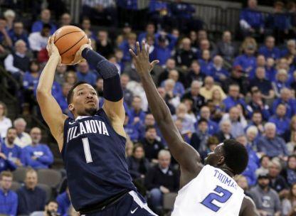 Villanova's Jalen Brunson (1) shoots over Creighton's Khyri Thomas (2) during the first half of an NCAA college basketball game in Omaha, Neb., Saturday, Feb. 24, 2018